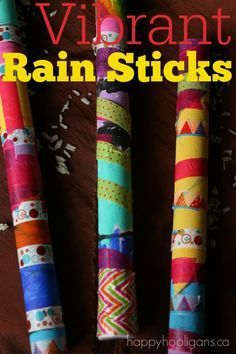 Easy Vibrant Rain Sticks for Kids to Make - Great craft for kids using paper towel rolls and dollar store washi tape!  The tape is a great fine-motor work out, and the preschoolers loved using it.  The 5-8 year olds really enjoyed making these rain sticks as well. - Happy Hooligans