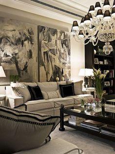 Traditional Living Room with Built-in bookshelf, Crown molding, Carpet, Restoration Hardware Lina Rug Latte, Chandelier