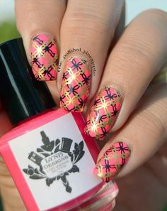 Bright pink/orange nail polish by LYNB Designs double stamped with black and gold by @the_polished_pineapple