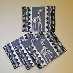 """Cool Giraffe Placemats"" Zimbabwe Textiles. Black, white, grey, with a giraffe and tribal print. TheseplacematsarehandprintedbyZimbabweanwomenwhoworkfromhome. TheirwaresarethensoldattheAvondaleMarketinHarare."