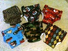 Cloth training pants for toddler boys. Fabric, pre-fold diapers, and PUL fabric. Side closure using Kam Snaps.