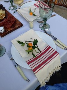Rehearsal dinner place setting. Yeah, that's a fresh picked kumquat napkin ornament. I'm not messin' around.