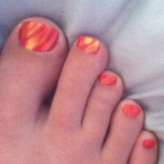 Desert sands toes. Layer sheer yellow over bright pink.
