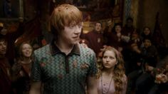 Rupert Grint as Ron Weasley and Jessie Cave as Lavender Brown