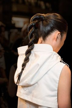 """""""We wanted to do a tough, matte rope braid,' """" said backstage hairstylist Allen Ruiz about the hairstyle created for Public School. """"It conveys strength, and echoes the strong lines from the collection."""""""