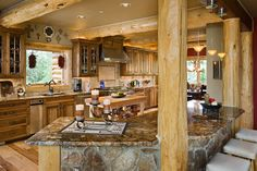 Other natural elements highlight this log home kitchen - Today's Log Homes for Advantageous and Luxurious Living - Style At Home, Log Home Kitchens, Dream Kitchens, Rustic Kitchens, Log Home Decorating, Decorating Tips, Cedar Homes, Log Cabin Homes, Log Cabins
