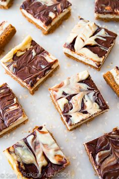 SUPER creamy cheesecake bars swirled with Nutella on a buttery graham cracker crust! Only 8 ingredients! Recipe on sallysbakingaddiction.com