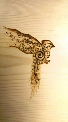 Songbird based on a tattoo design  pyrography (wood burning)