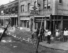 (via Detroit News Online) This picture was taken during the Detroit riot of which began after city police raided an unlicensed after-h.