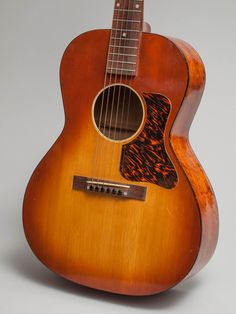 1936 Gibson made Grinnell Special Spanish in excellent condition.  Grinnell Brothers was the largest music retailer in Michigan in the 1930s.  They had Gibson make them a house brand in the mid 30s.  This guitar is similar to a Kalamazoo Oriole however it has a gorgeous sunburst finish and the way-cool Grinnell logo on the peghead.