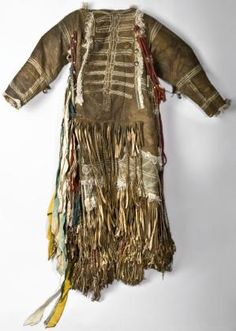 "This female shaman's caftan with a breastplate (hamnar ton) belonged to a ""big"" shaman of the Tofalar people who inhabited the northern slope of the eastern Sayan Mountains.      Irkutsk region, East Siberia      Russia       19th Century"