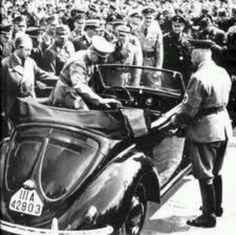 May 26, 1938... Ferdinand Porsche holds door open for Adolph Hitler.