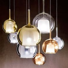 """Small Glo Pendant Light  From Penta  Glo is one of the iconic lamps of Penta, designed by Carlo Colombo. This collection, available as table, floor and pendant lamps, gives a strong scenic impact to the different interior design solutions. Available in different colours: transparent, gold, silver, pink gold, black, iridescent and in the new proposal """"4ever"""" and """"total white"""". The design of this product creates enchantment and abstraction in all living space.  $760.00"""