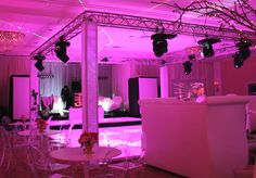 A four-corner truss setup is a popular way to highlight and enhance a dance floor. The four-corner truss typically has numerous intelligent and decorative light fixtures affixed to the top around all sides. In addition to providing lighting and serving as its own form of décor, the four-corner truss creates hanging points where Swarovski crystals, video screens and more can float above the dance floor. The footprint and height can be customized to virtually any room or dance floor size.