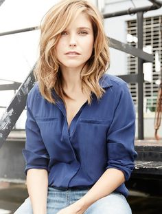 Sophia Bush wearing a blue silk blouse from Joe Fresh. A versatile fall piece that can be worn day and night. Pair it with a chic blazer and yummy ear candy.