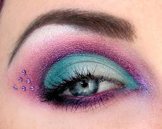 Pretty purple and teal eye shadow with small purple crystal accents.