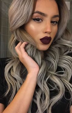 Shiny highlight, dark lipstick and full hair