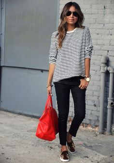 this outfit is my jam. slouchy striped shirt, black skinnies, patterned kicks, gold jewelry and a bold colored bag