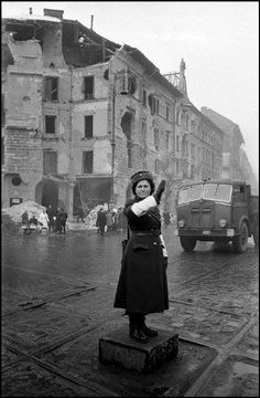 Aftermath of the Hungarian Revolution:a policewoman directs non-existing traffic at a Budapest crossing. Old Pictures, Old Photos, Ruined City, Magnum Photos, Budapest Hungary, Historical Photos, Homeland, Places To See, The Past