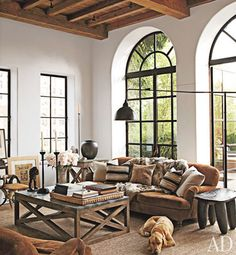 exposed wood beams, beautiful light, arched windows.  Sigh.