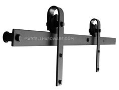 """This wrought iron overhead flat track rolling door hardware kit includes all necessary components to hang 1 door. This kit is a basic smooth wheel carrier design with a 5' overhead flat track with a 1 3/8"""" standoff in brown rust, dark bronze, flat black or red rust powder coat finish."""