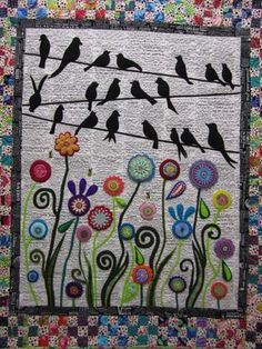 Wendy Williams quilt - isn't it clever! Note the newsprint background.  #wendy williams #bird quilt