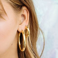 We literally can't keep these bad boys in stock. Pre-order the Amalfi Hoops + Baby Amalfi Hoops now at LuvAj.com | Under The Classic Hoops Collection
