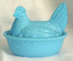 Turquoise blue milk glass butter dish, early 20th century, possible Kemple or Westmoreland., but not marked other than with number 4 in the lid. Excellent condition, no chips or breaks, good detailing of the nest and hen, diamond basketweave base with beaded rim.