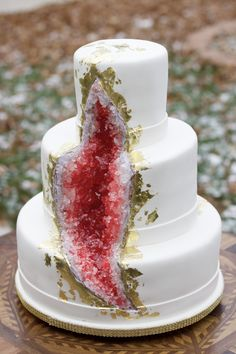 Geode wedding cake Scarlett red, edible sugar and gold leaf