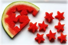 Using a cookie cutter to cut watermelon into cute shapes. Great idea for the forth of July.
