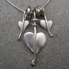 Heart leaf necklace http://www.silverandstone.co.uk/html/gold_silver_necklaces_pendants.html. I love, love, love this.