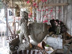 spring 2011 - another wonderful vignette from my friend, Sandy's, shop.  (Omg! at Glory Days Antiques)