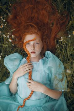 mythical portrait of a red-headed and a corn snake | by Katerina Plotnikova