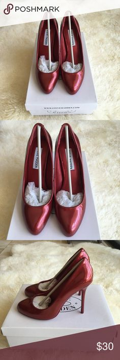 "Brand New W/Box - Steve Madden Red Heels BRAND NEW IN BOX-NEVER WORN.          This shoe is very stylish and extremely comfortable to walk around in! Height: 4"" Material: All Manmade Material Color: Metallic Red  I have to sell it simply because I have hundreds pair of shoes. And this beautiful pair deserve some love <3 Steve Madden Shoes Heels"