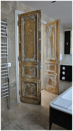 Salvaged Doors - beautiful old doors, partially stripped, with the old paint layers left behind to highlight the details - via Mannalisa
