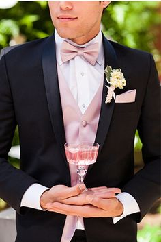 Groom is wearing the Lorenzo Tuxedo complete with blush pink champagne! https://www.friartux.com/index.php?route=blog/blog/post&id=3569#.U_eVXMVdUSZ
