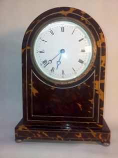 Rare tortoiseshell clock with silver inlaid stringing.