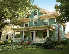 blue-green shirtwaist foursquare house with cream trim
