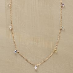 """SAPPHIRE DEWDROP NECKLACE--Lavishly faceted dainty droplets rain out from this pastel sapphire drop necklace, held together by a strand of delicate 14kt gold links. The rainbow of pastel sapphires ranges from white to lavender, blue to green. Spring ring clasp. Handmade in USA by Kyoko Honda. 16""""L."""