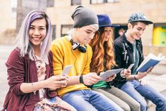 Multiethnic Group Of Friends Looking Down At Phone And Tablet, Concepts About Technology Addiction And Youth Stockfoto 398586526 : Shutterstock Generation Z, What Is Html, Javascript Course, Technology Addiction, Job Satisfaction, Start Ups, Group Of Friends, Commerce, Reading Skills