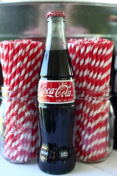 Oooo let's do glass coke bottles with red straws. i know where to get the long soda bottle straws. stripes or polka dots? we can see if it looks good or not to add a straw tag.