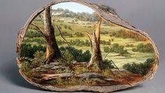 Ağaç kütüklerinin üzerine yapılmış 13 manzara resmi