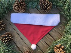 Now your pet can fit right in this Christmas. Your pet will look amazing with this Santa hat slide over the collar bandana. It is a red bandana with white fur like plush felt at the top and a white pom pom at the bottom of the bandana. The bandanas are made of quality