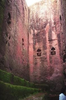 The rock-hewn churches of Lalibela.   Ethiopia    They are not called the 'Eighth wonder of the world' for no reason. Situated inside the same rock from which they were carved out, rock-hewn churches of Lalibela are a marvel of architecture that are seldom paralleled even in the modern world. Some of these churches were built in 12th century during the rule of King Lalibela, and some were built earlier in the 10th century. Bete Medhane Alem, is perhaps the largest monolithic church in the wo...