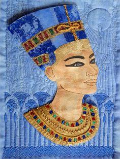 Nefertiti on Blue by Shirley Anne Sherris. Quilts, fabric crafts, mixed media, bust, Egyptian, embroidery, beading. http://shirleyannesherris.blogspot.com/2007/10/found-time-at-last.html HI-RES: http://3.bp.blogspot.com/_lJNrWP9rFQ0/RwvTHtXb4oI/AAAAAAAAAFc/gHKApmISb6g/s1600-h/Nefertiti-on-blue.gif