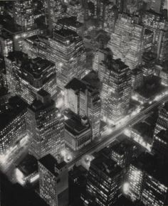 New York at Night  Berenice Abbott, 1932  Taken from an upper floor of the Empire State Building at dusk just before Christmas, 1932, this image imparts a magical twinkle suitable for the season, thanks to a special developer Abbott used to render the contrasts between light and dark.