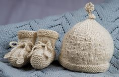 Ravelry: Rock a Bye Baby Hat and Booties by Little cupcakes - Bc33 pattern by Lisa Craig