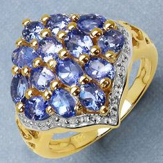 2.38CTW Genuine Tanzanite 14K Yellow Gold Plated .925 Sterling Silver Ring - http://www.johareez.com/shop/justbuyit/rings/2-38ctw-genuine-tanzanite-14k-yellow-gold-plated-925-sterling-silver-ring-2-27247/$10622951