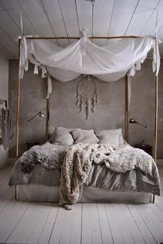 American-Indian inspired bedroom, dream catcher floats at the head of a beautiful faux animal hide bedding in cool whites