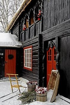 those architectural details around the door and upper windows/walkway? and the colors......only in Sweden.